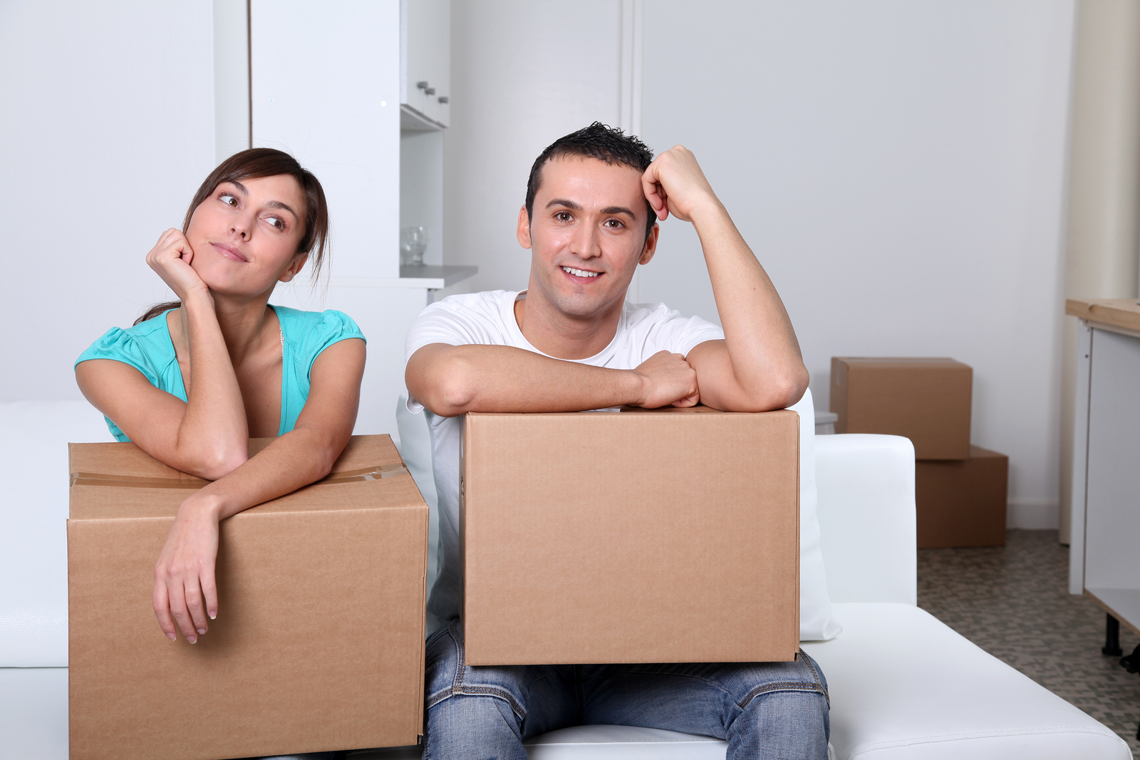 bigstock-Young-couple-moving-in-new-pla-17001401